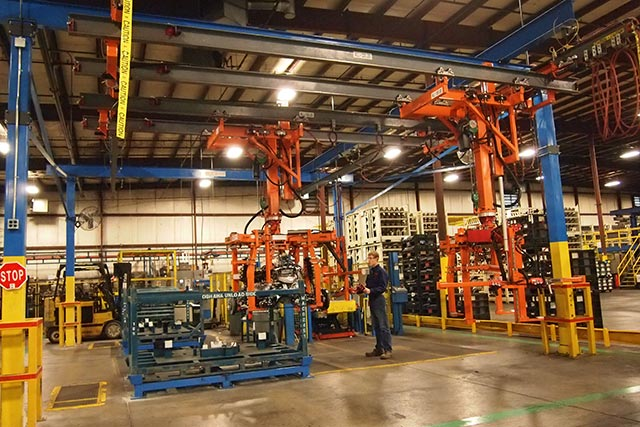 Two huge steel slide column manipulators meant to carry a 1000-lb assembly