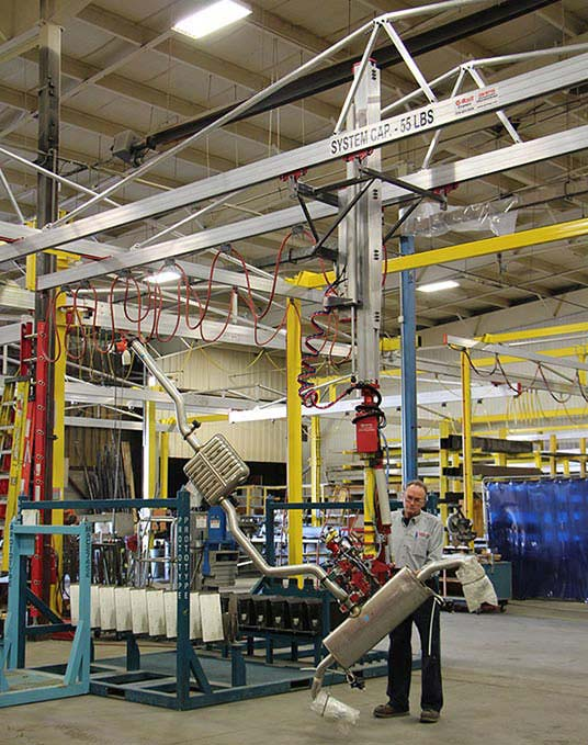 SC5 Slide Column manipulator with a very complex end effector for lifting and rotating exhaust systems by Givens Engineering Inc.