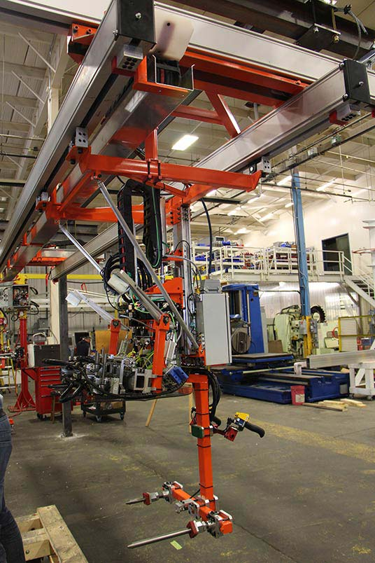 Slide Column manipulator suspended between 2 KBK bridges by Givens Engineering Inc.