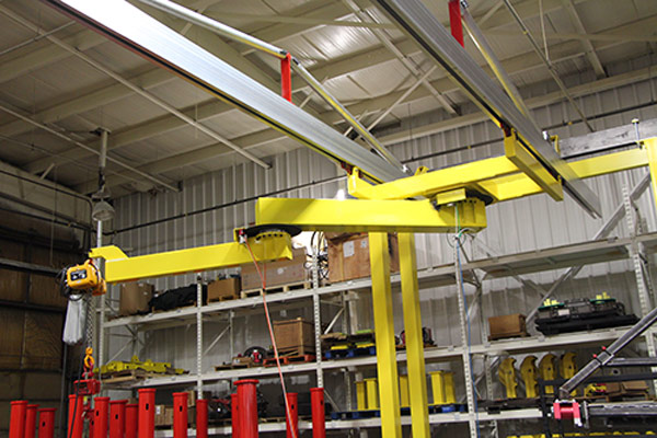 AJ200 articulated jib crane mounted on C2000 bridge crane rail manufactured by Givens Engineering Inc in Canada.