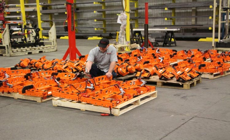 Conveyor hangers and rotators by Givens Engineering Inc. manufactured in Canada.