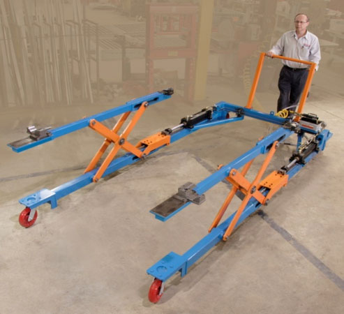 Hydraulic scissor lift for extracting car bodies from the assembly line for testing by Givens Engineering Inc. manufactured in Canada.